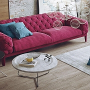 A Living Room with Pink Couch on a 360 Virtual Tour