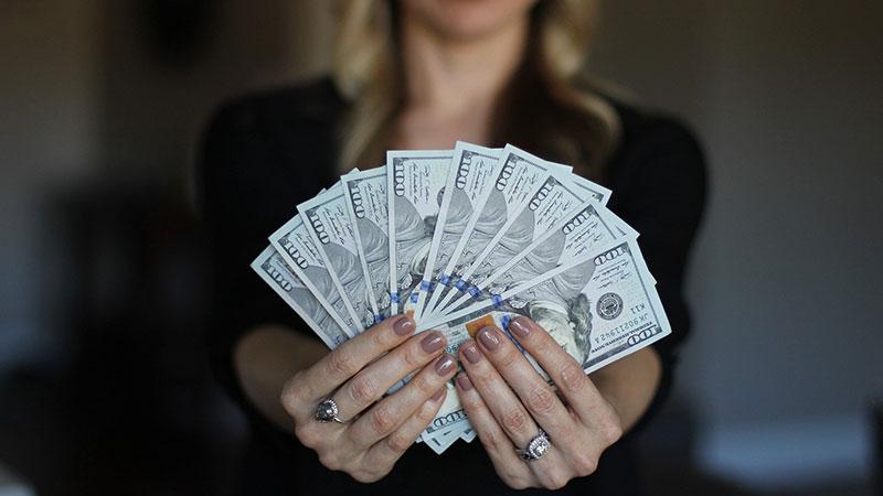 A Woman Realtor Enjoying Benefits of Saving Money with Virtual Staging