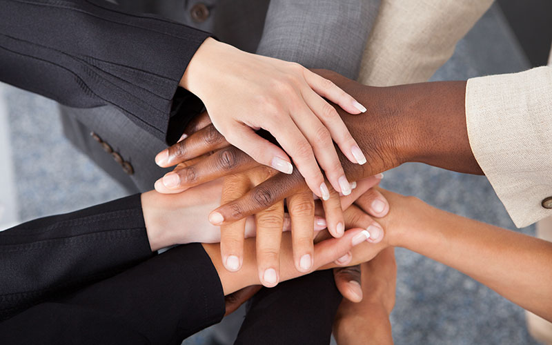 A Stack of Hand of a Real Estate Agent and Their Local Business Partners
