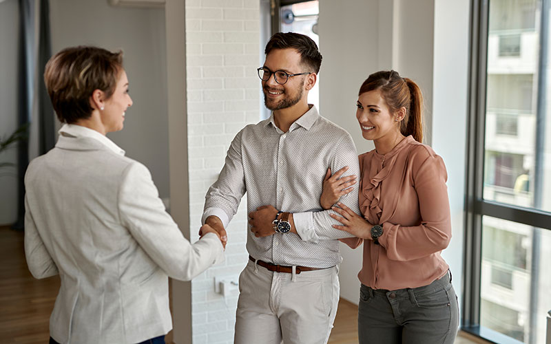 A Real Estate Agent Shaking Hands with Prospects