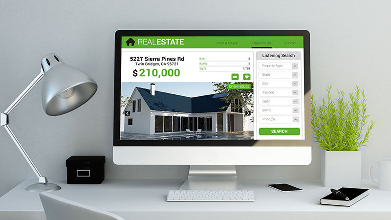 A Computer with Real Estate Website Which Is One of the Most Powerful Marketing Solutions