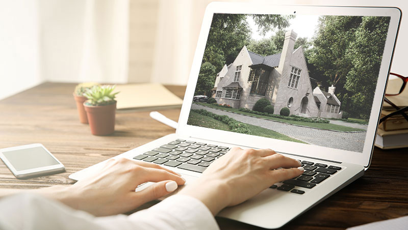 A Real Estate Agent Uploading CGI of a House to the Website